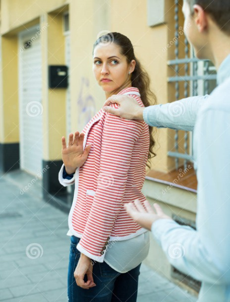 Annoying Salesman bugging a busy lady with his product
