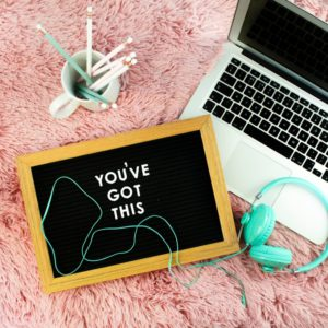 laptop-headphones-pencils-and-mini-blackboard-saying-you