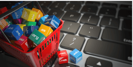 Red shopping basket full of colourful cubes with Top Level Domains on them